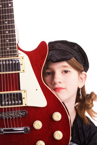 Girl learning electric guitar
